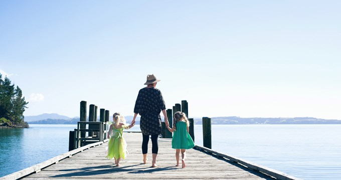 mum walking on jetty with two daughters